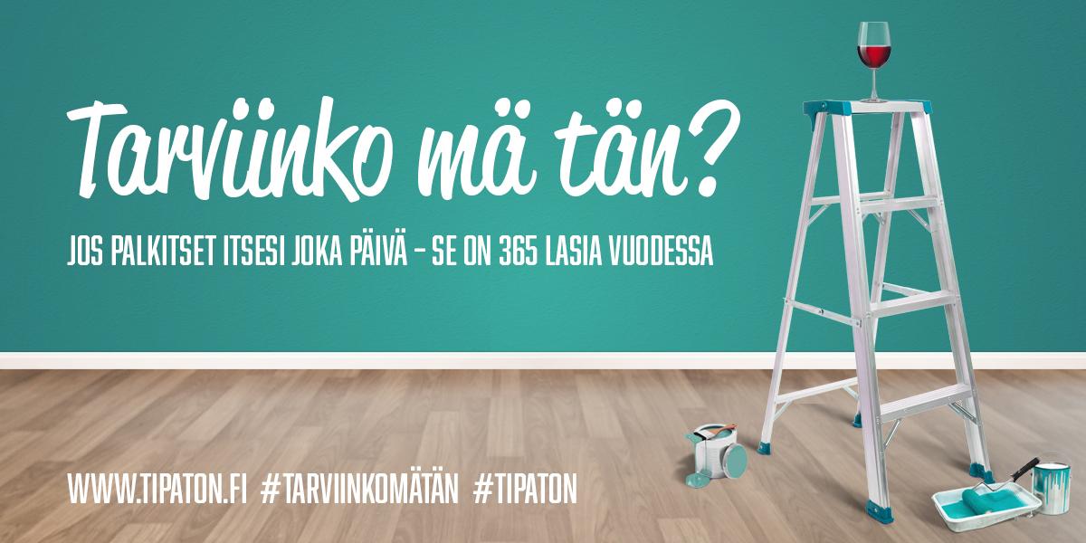 Punaviinilasi A-tikkaiden päällä ja trendikkäällä värillä maalattu seinä sekä teksti: Tarviinkomätän? Jos palkitset itsesi joka päivä, se on 365 lasia vuodessa. www.tipaton.fi #tarviinkomätän #tipaton